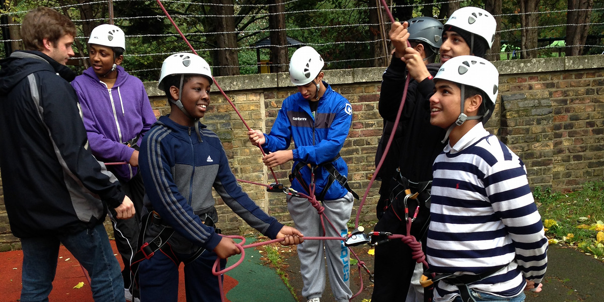 Students take part in a rock wall climb