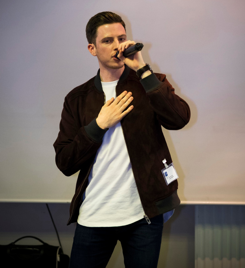 Local rapper Nick Brewer performs