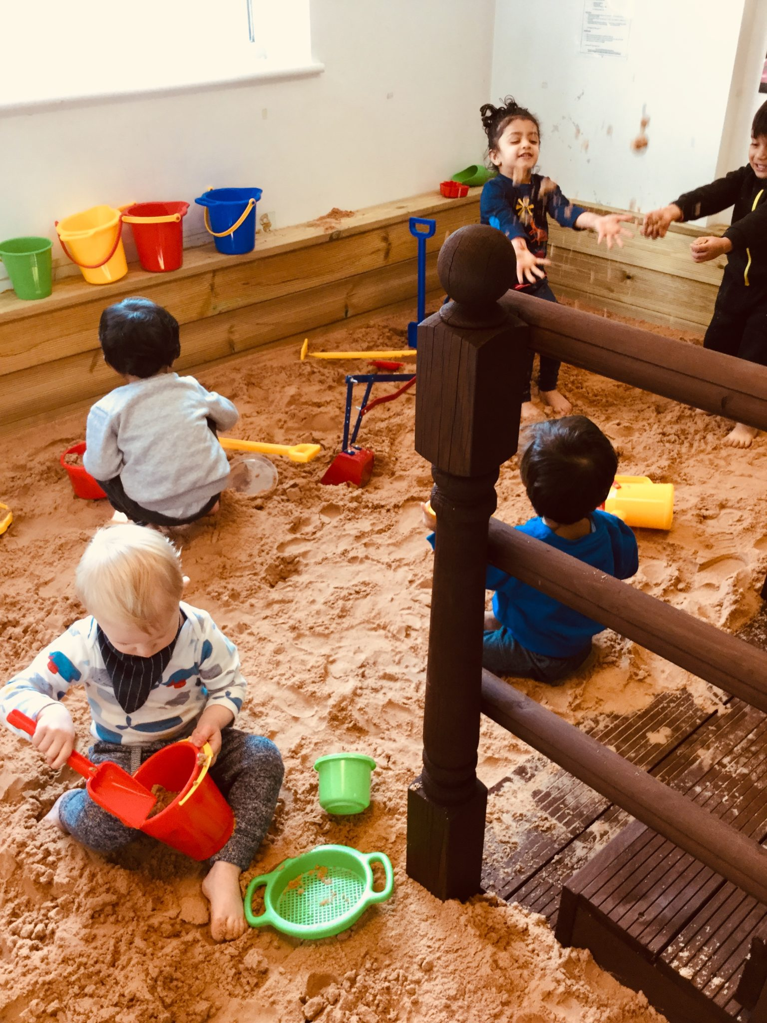 Children playing in giant sandpit